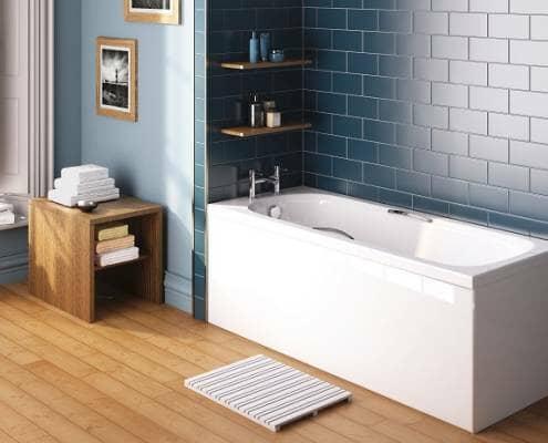 Straight bath against tiled wall
