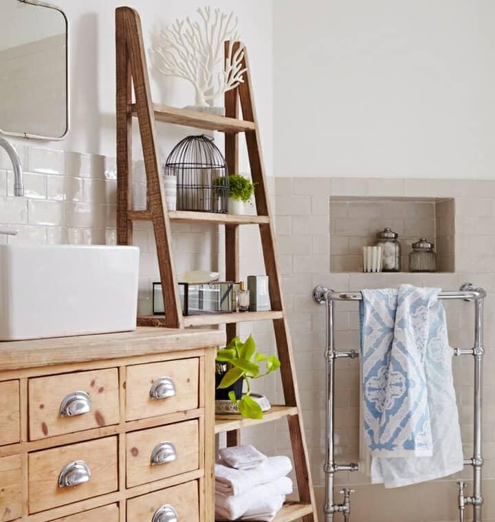 Rustic wooden bathroom furniture with vintage heated towel rail