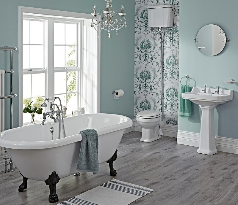 vintage bathroom with freestanding bath with black claw feet, and white toilet and basin set