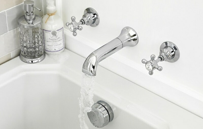Chrome wall mounted bath spout and traditional tap handles
