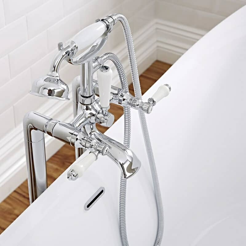 Chrome freestanding bath mixer tap with hand shower and white handles