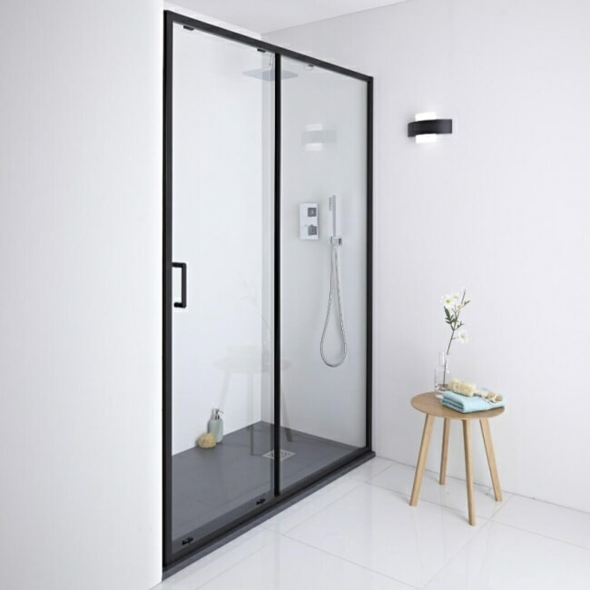 sliding shower door with black frame