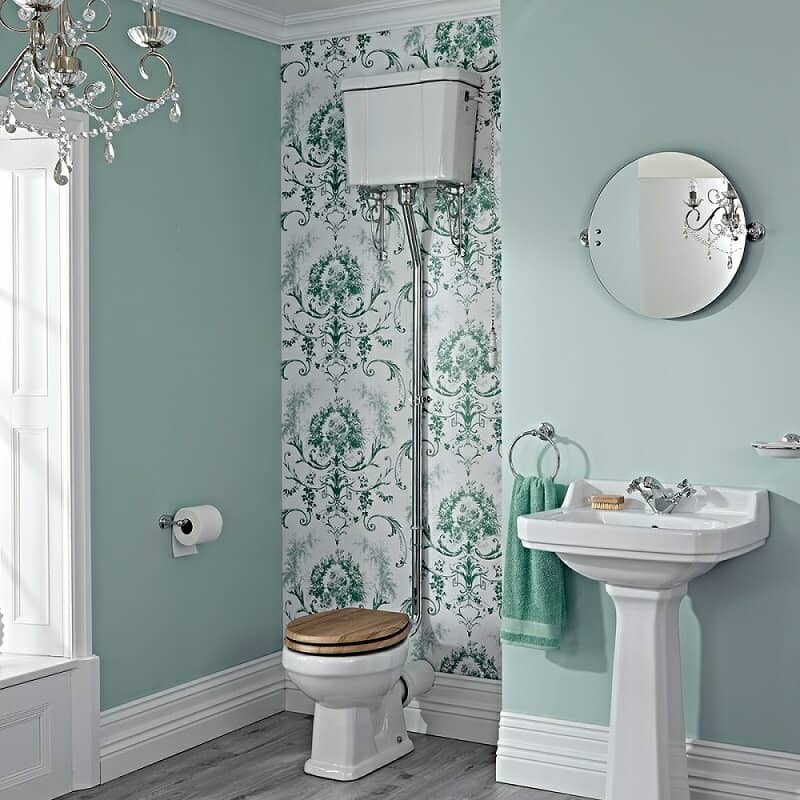 Vintage high level toilet with pull chain in green floral design vintage bathroom