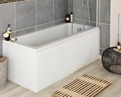 Straight acrylic bath fitting into corner of bathroom, with bath shower screen and bath filler tap