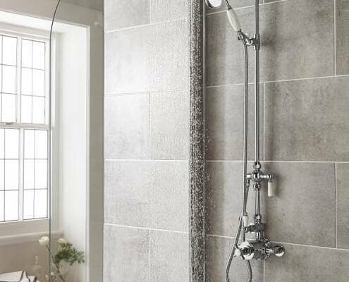 vintage style thermostatic mixer shower installed in a modern tiled bathroom