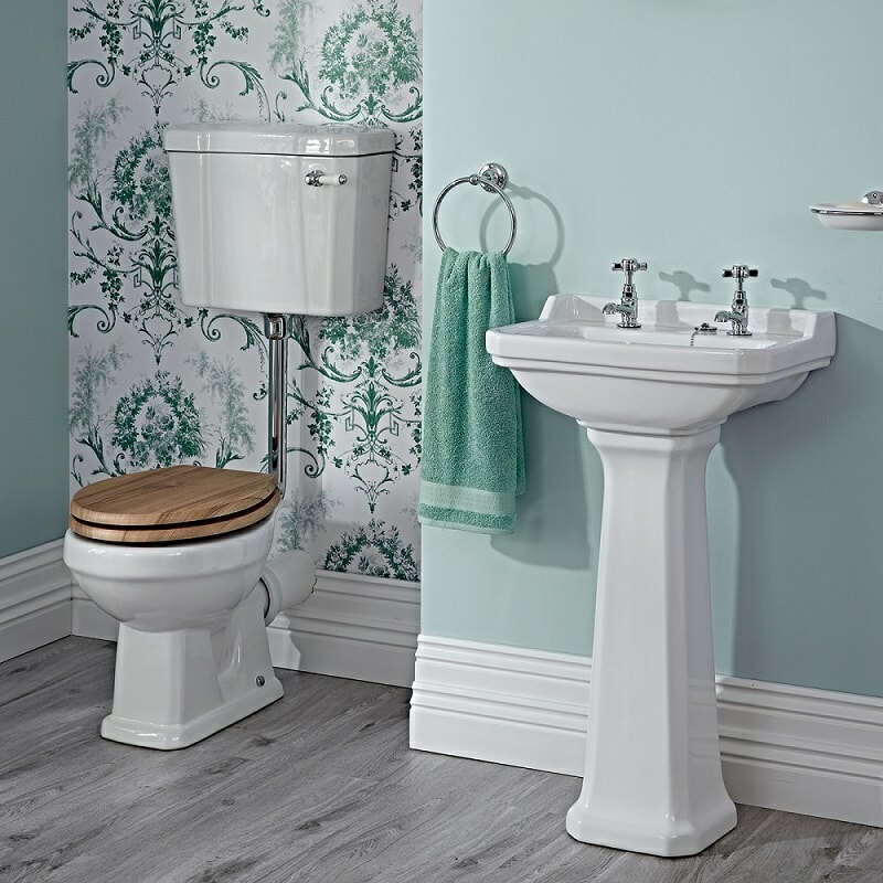 low level toilet in green vintage bathroom
