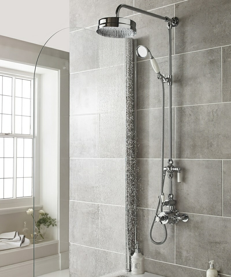 traditional shower with rain shower head and hand shower