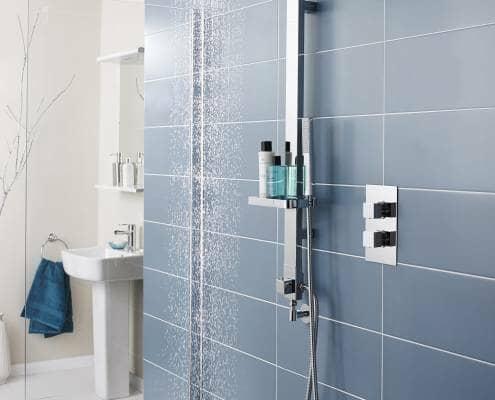 modern shower against a blue tiled wall