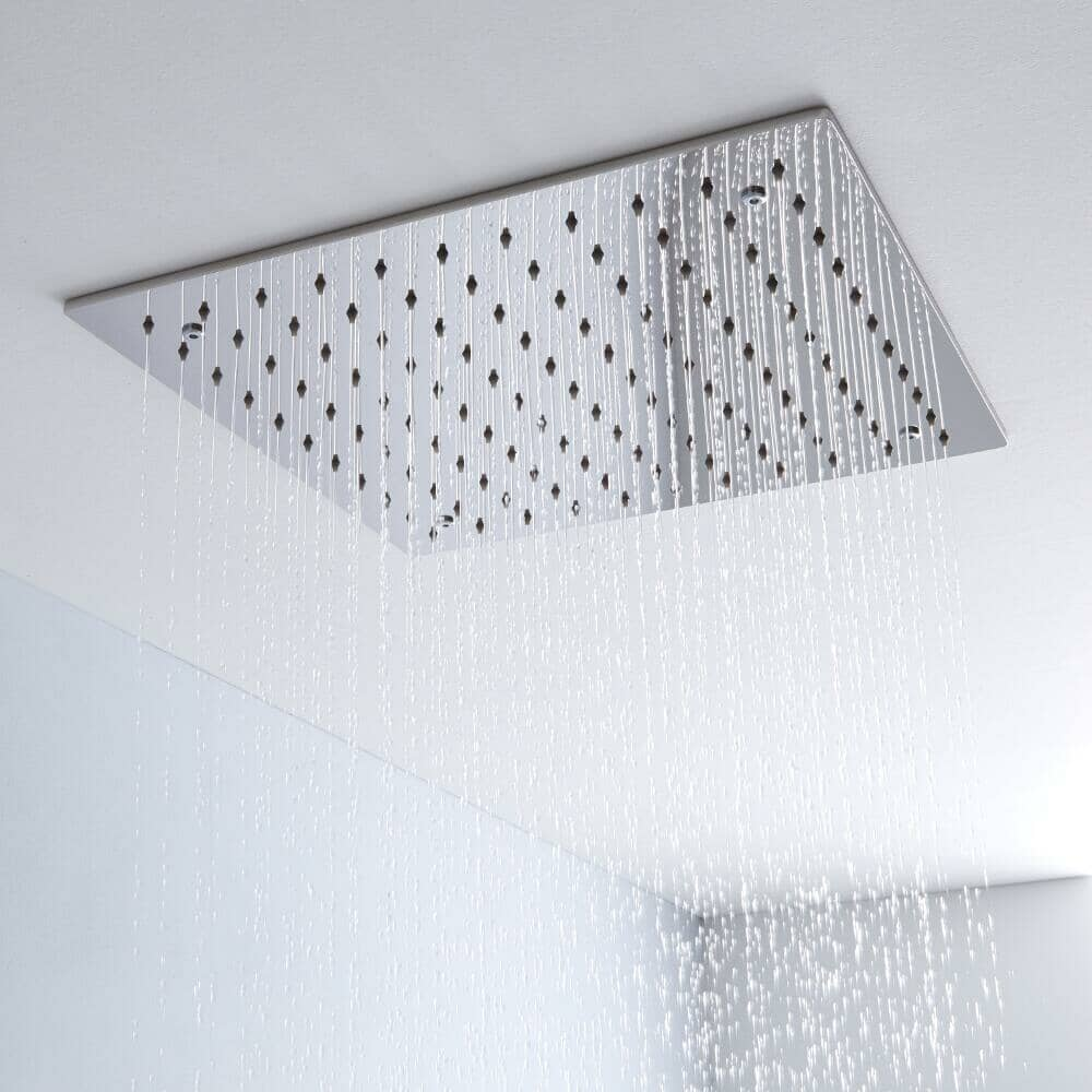 chrome rainfall shower head fitted into the ceiling