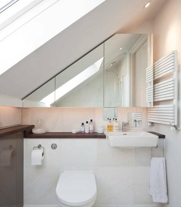 Loft en-suite bathroom with toilet and basin