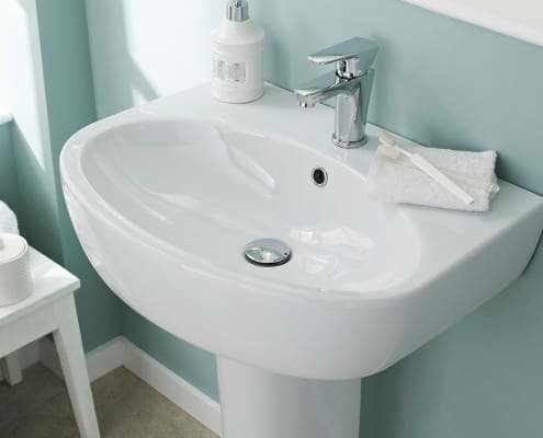 Pedestal basin with waste and tap - close up