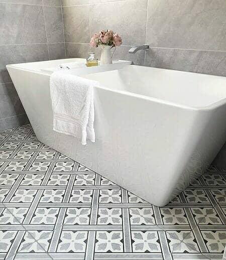 a modern bathtub in a modern bathroom suite