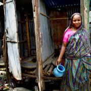 Toilets in bangladesh with a woman in traditional clothing