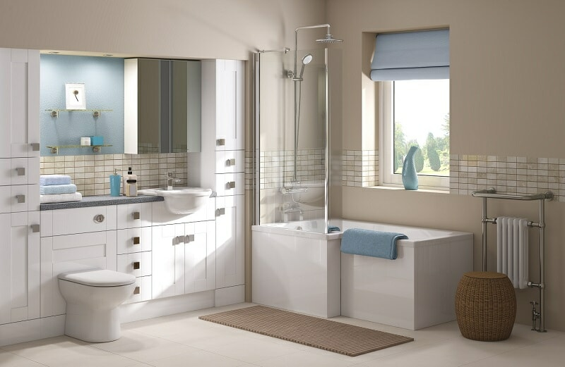 modern bathroom suite in beige with white storage units and bath