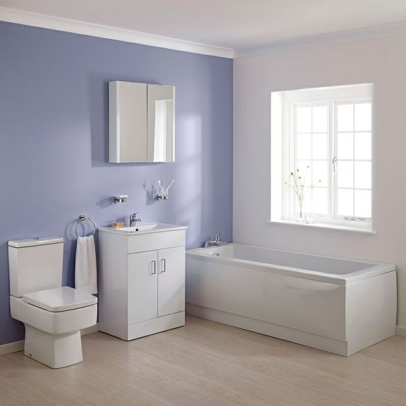 White bathroom suite in a purple and white bathroom