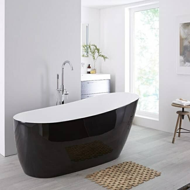 Modern freestanding bath with white interior and black exterior finish.