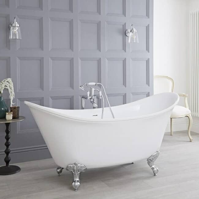 double ended freestanding slipper bath with classic freestanding taps and shower handset in a traditional spacious bathroom