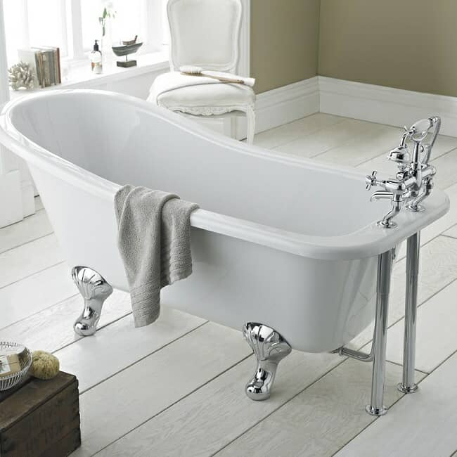 Traditional single ended slipper bath with chrome feet and deck mounted taps with shower handset