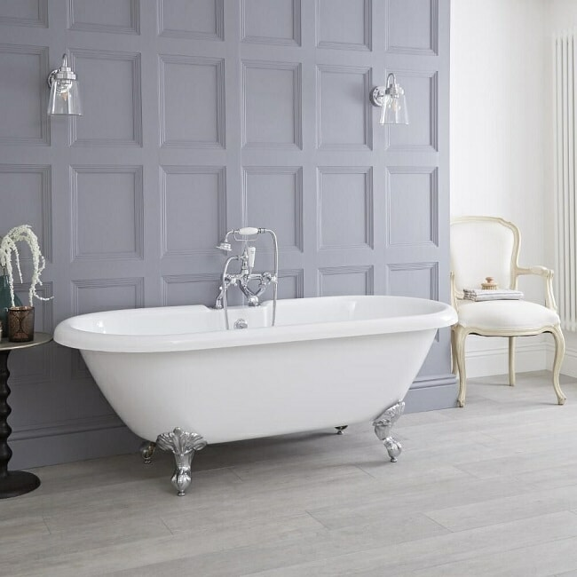 roll top freestanding bath with claw feet and traditional shower tap set