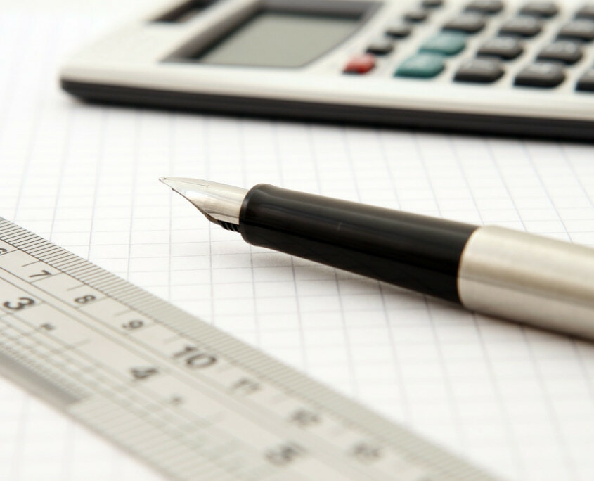 Fountain pen, calculator, and ruler