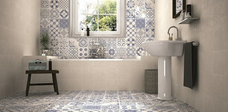 Bathroom with blue patterned tiles in various designs.