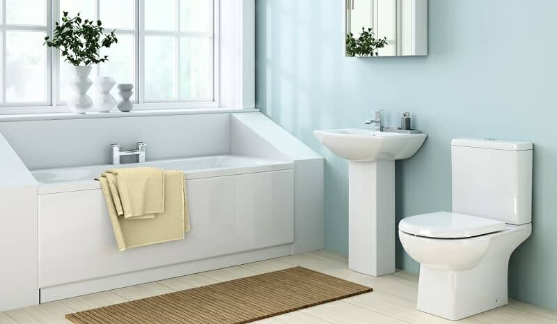 Duck egg blue bathroom with white bath, sink, and toilet