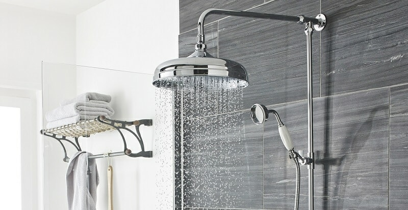 vintage shower with chrome shower head, pipes and white handled shower handset