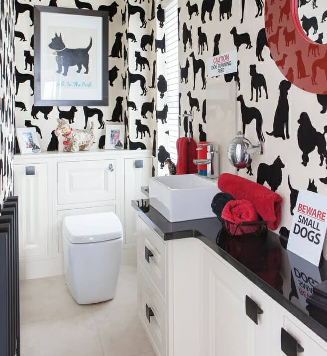 cloakroom suite with bold wallpaper