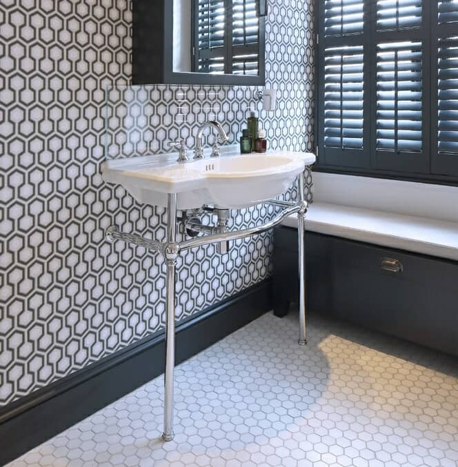 grey bathroom with traditional washstand and pattered walls