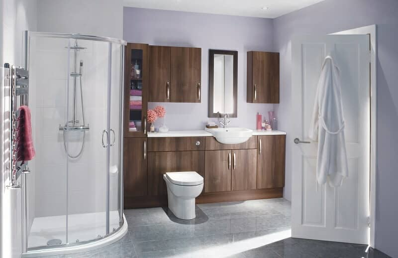 Modern bathroom with wooden storage units with integrated basin and toilet. With Quadrant shower.