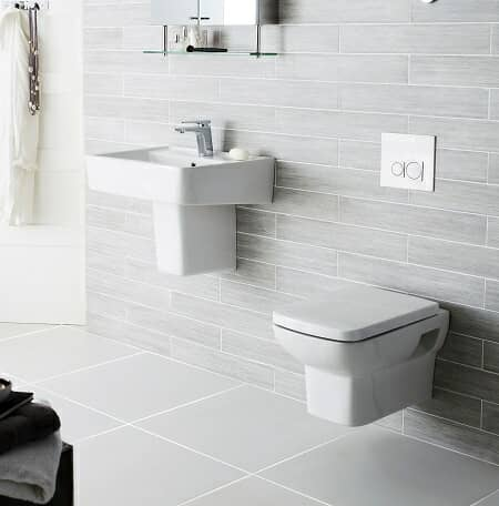 White wall mounted basin and toilet in light grey bathroom