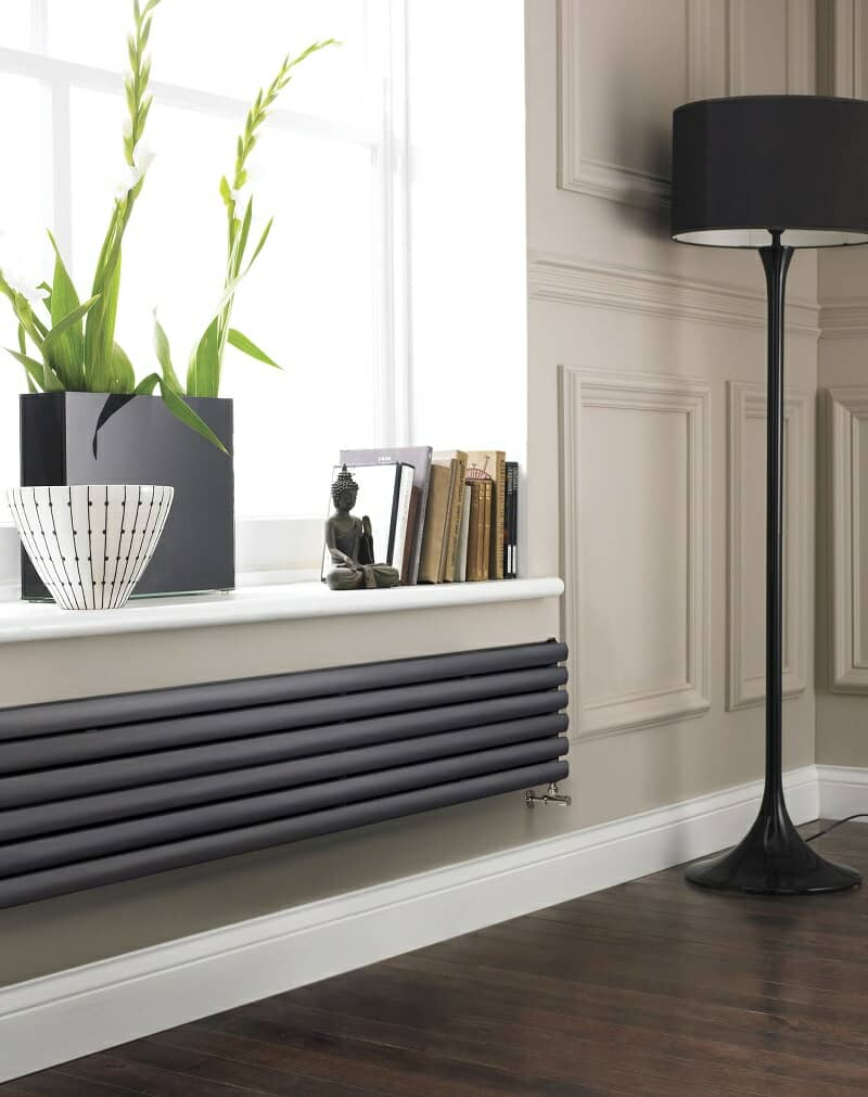 Horizontal designer radiator under window ledge