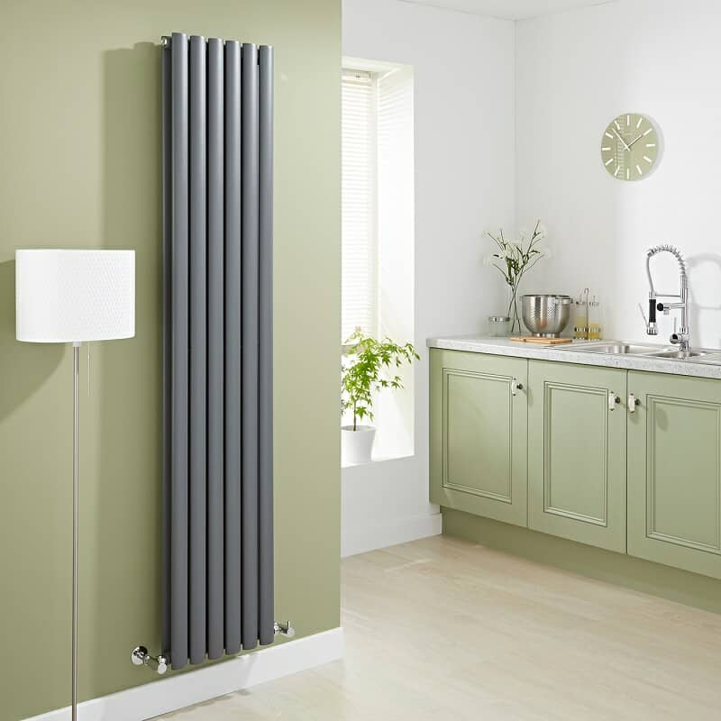 Vertical anthracite designer radiator in an olive green kitchen