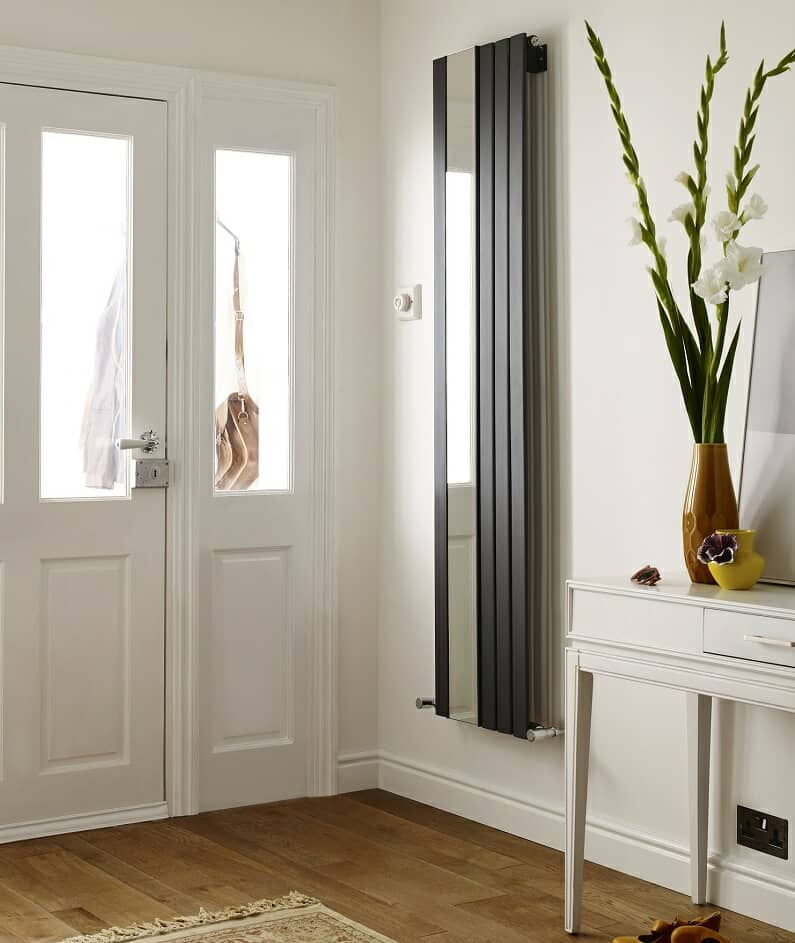 vertical designer radiator with mirror in entrance hallway near front door