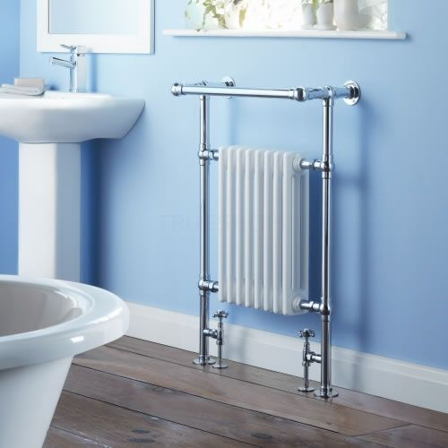 White column traditional towel rail on blue wall