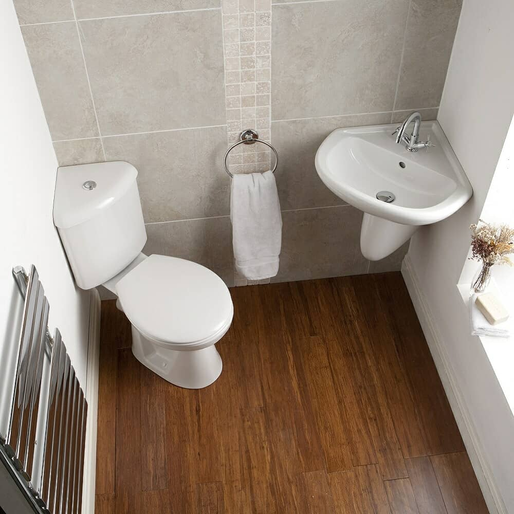 Corner cloakroom suite with corner toilet and corner semi pedestal wall hung basin
