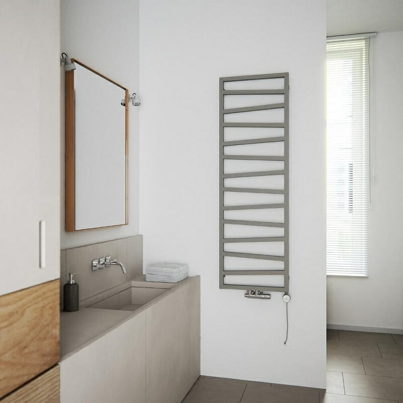 Modern designer towel rail with irregular bars in grey, on a white wall.