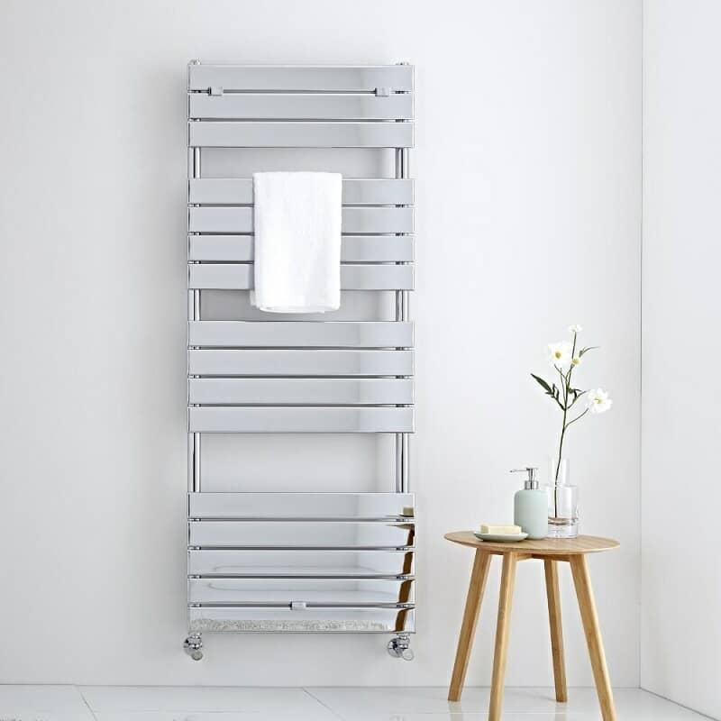 Large chrome heated towel rail on white wall