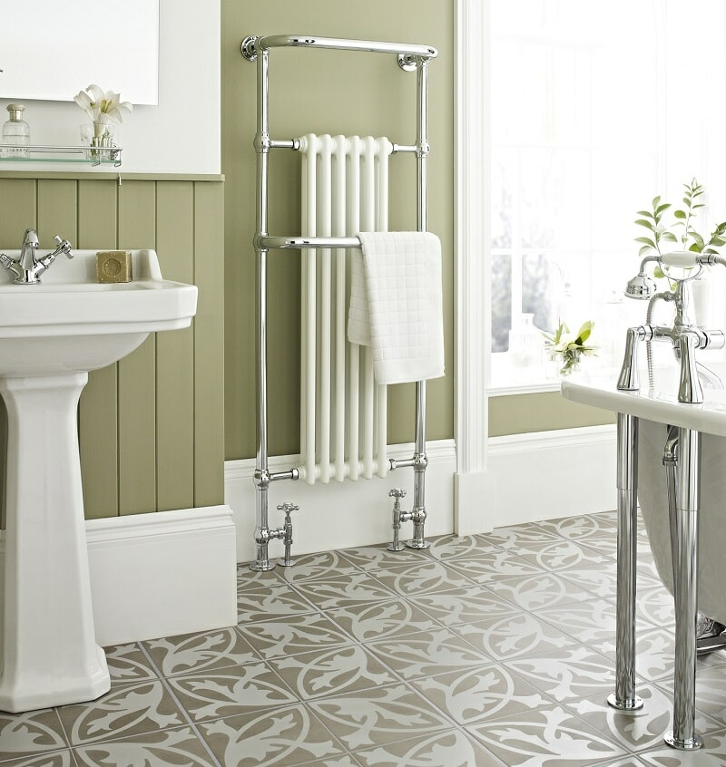 Green traditional bathroom with vintage style towel rail and sink