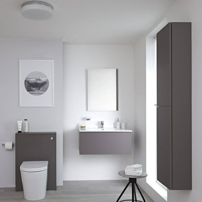 Grey bathroom furniture set with vanity unit, toilet unit and cabinet.