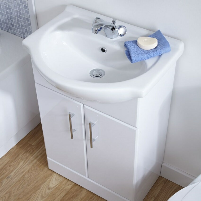 white gloss vanity unit with basin and mixer tap