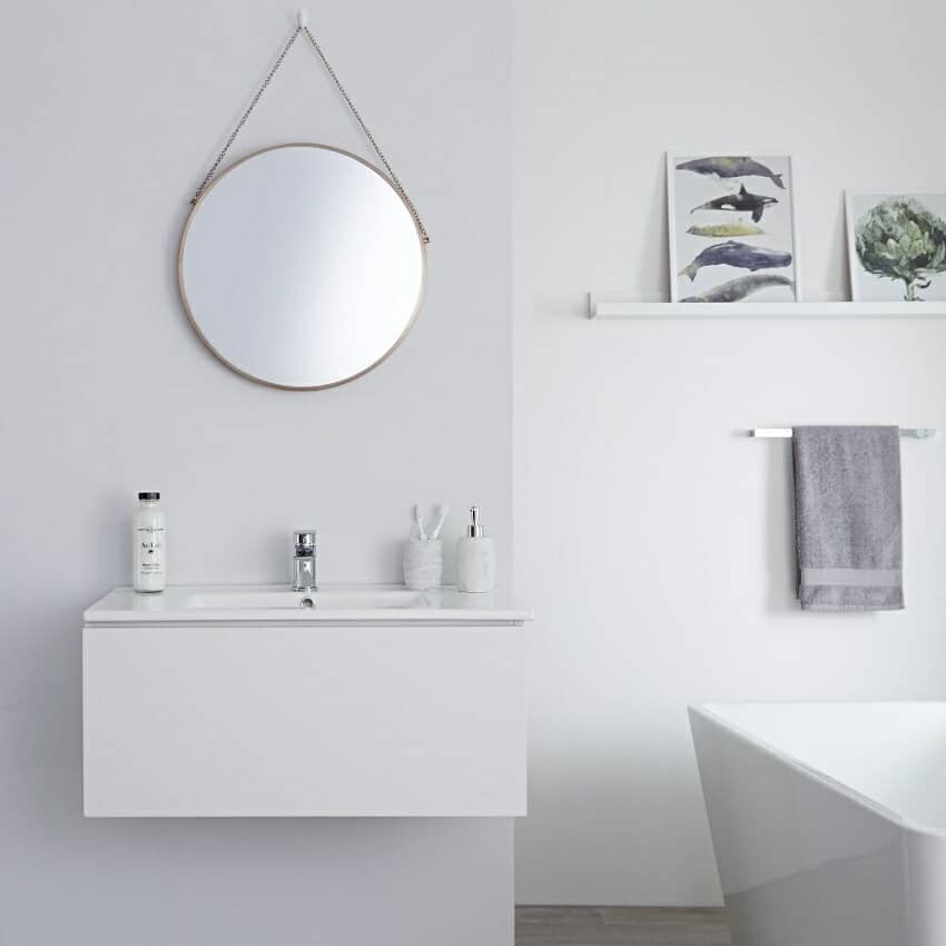 Wall hung vanity unit in white with mono tap, accessories, and mirror
