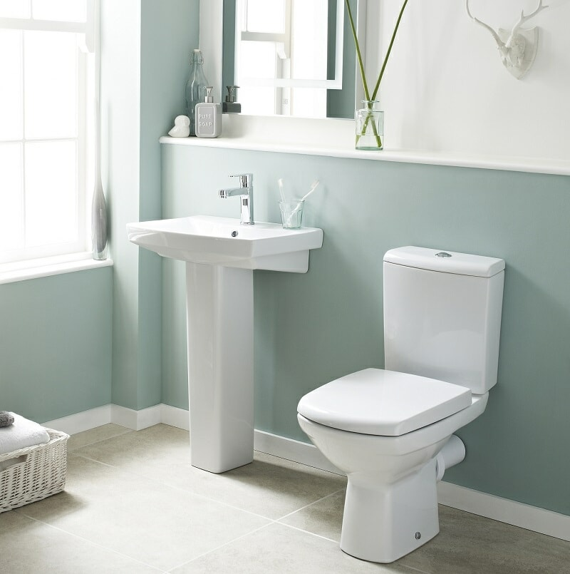 green-grey designer cloakroom suite with white angular pedestal basin and toilet.