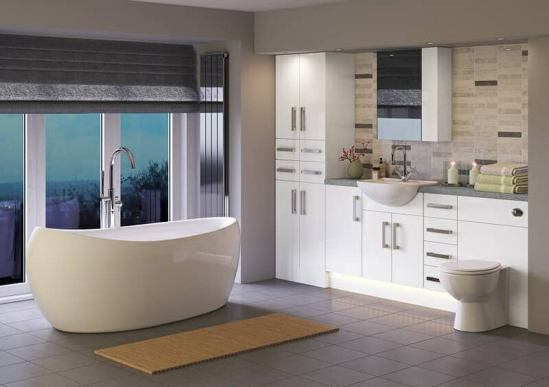 Moody lit bathroom with under lighting, spot lights, candles, and modern freestanding bath