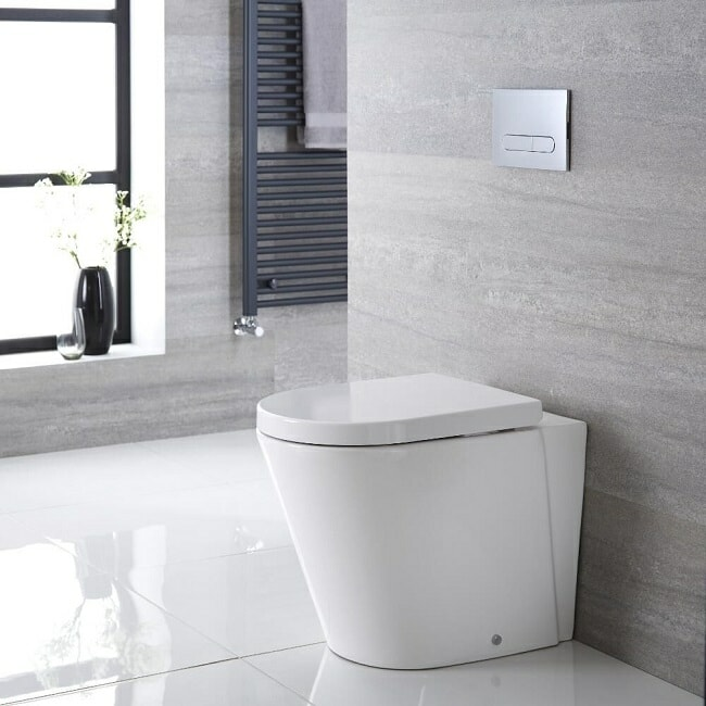 white back to wall modern toilet in modern bathroom