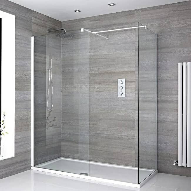 walk in shower with rectangular white shower tray and drying area