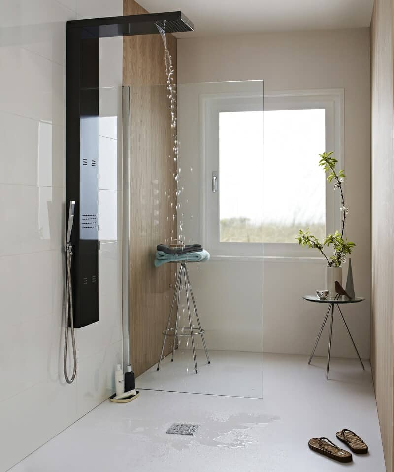 modern wet room with black shower tower and minimalist furniture