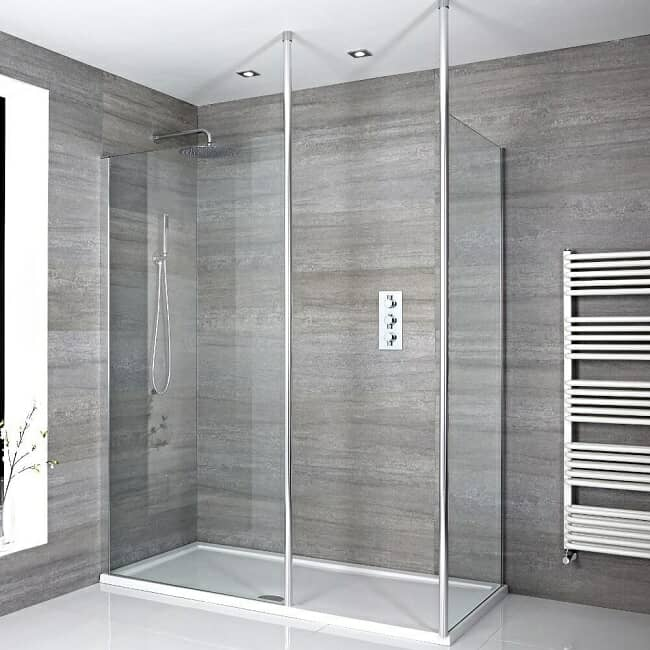 corner walk in shower with chrome supports and white tray