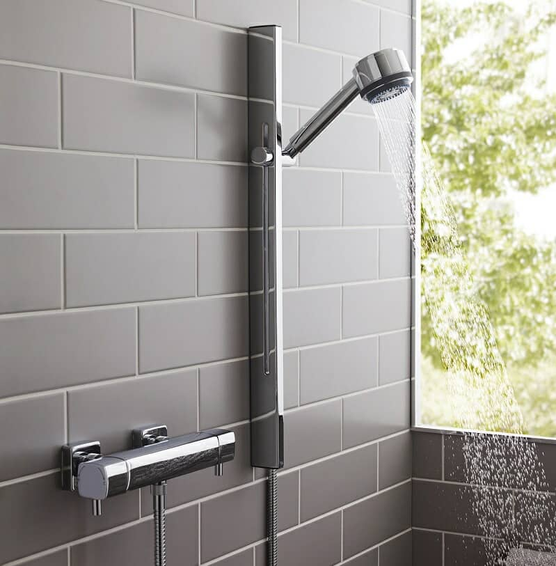 exposed shower valve with modern shower head and sliderail