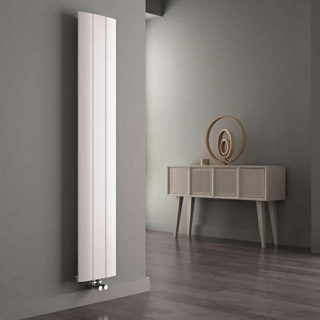 white vertical designer radiator in grey room with natural furniture